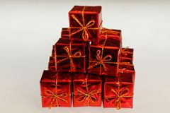 Bright, olourful beautifully wrapped presents in a pile royalty free stock photos
