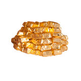 Wrapped chocolates isolated. Wrapped chocolate sweats in gold papers isolated on white Royalty Free Stock Photography
