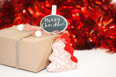 Wrapped Christmas gift box on red sparkling background Royalty Free Stock Image