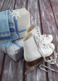 Wrapped Christmas gift and skates Royalty Free Stock Image