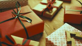 Wrapped christmas gifts on brown wooden table stock video