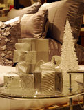 Wrapped Christmas gifts on a glass table. Next to the bed (converted to monotone Stock Photos