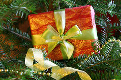 Wrapped christmas present near the christmas tree Stock Photo