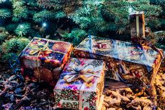 Wrapped Christmas Presents Under the Christmas Tree with Lights. Holiday Theme royalty free stock image