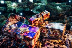 Wrapped Christmas Presents Under the Christmas Tree with Lights. Holiday Theme stock photos