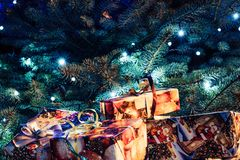 Wrapped Christmas Presents Under the Christmas Tree with Lights. Holiday Theme stock photo