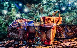 Wrapped Christmas Presents Under the Christmas Tree with Lights. Holiday Theme stock images