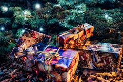 Wrapped Christmas Presents Under the Christmas Tree with Lights. Holiday Theme royalty free stock photo