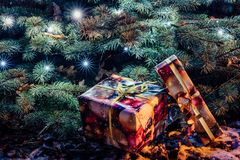 Wrapped Christmas Presents Under the Christmas Tree with Lights. Holiday Theme royalty free stock photography