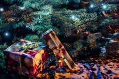 Wrapped Christmas Presents Under the Christmas Tree with Lights. Holiday Theme stock image