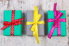Wrapped colorful gifts for Christmas or other celebration on old white plank Royalty Free Stock Photos
