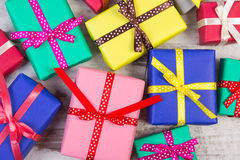 Wrapped colorful gifts for Christmas or other celebration on old white plank Stock Photo