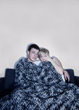 Couple listen to horror or suspense movie! Royalty Free Stock Photo