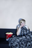 Girl listen to horror or suspense movie alone. Stock Photos