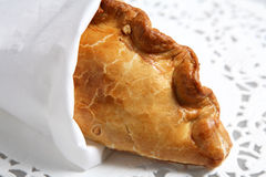 Wrapped cornish pasty meat pie on doiley royalty free stock image