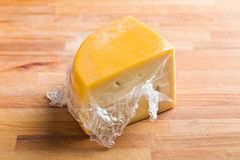 Wrapped edam cheese Royalty Free Stock Image