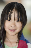 Wrapped in flag. Pretty young Asian girl wrapped in an American flag Royalty Free Stock Photography