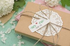 Wrapped gift and flowers Stock Photo