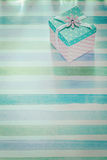 Wrapped gift box on blue striped fabric holidays concept Stock Images