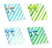 Wrapped gift box with a bow and ribbon Stock Photos