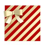 Wrapped gift box with a bow and ribbon. Wrapped vinous red gift box with a golden bow and ribbon isolated over white background, 3d render illustration Stock Images