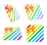 Wrapped gift box with a bow and ribbon. Wrapped white gift box with a rainbow colored bow and ribbon isolated over white background, 3d render illustration, set Royalty Free Stock Photos