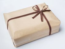Wrapped gift box and bow tie Stock Image
