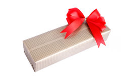 Wrapped gift box with red ribbon bow Stock Photos