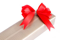 Wrapped gift box with red ribbon bow Royalty Free Stock Image