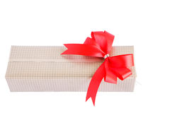 Wrapped gift box with red ribbon bow Stock Photography