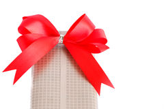 Wrapped gift box with red ribbon bow Royalty Free Stock Images