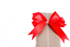 Wrapped gift box with red ribbon bow Stock Photo