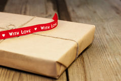 Wrapped gift box with red ribbon Stock Image