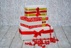 Wrapped gift boxes and red garland Royalty Free Stock Photography