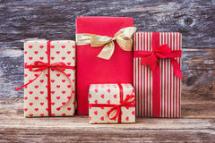 Wrapped gift boxes on wooden background. Toned, vintage style Stock Photo