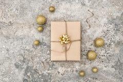 Wrapped gift christmas decoration concrete stone background Stock Photo