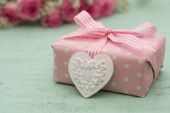 Wrapped gift and heart Royalty Free Stock Photography
