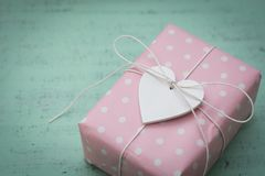 Wrapped gift with heart Stock Images