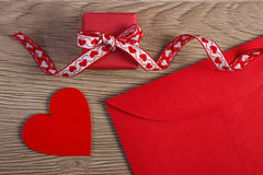 Wrapped gift, red heart and love letter for Valentines Day, copy space for text Stock Photo