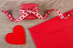 Wrapped gift, red heart and love letter for Valentines Day, copy space for text Royalty Free Stock Images