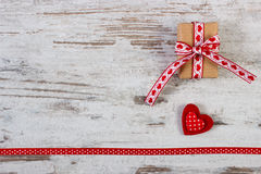 Wrapped gift, red heart with ribbon for Valentines Day, copy space for text Stock Images