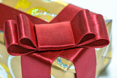 Wrapped gift with red ribbon and bow Stock Photography