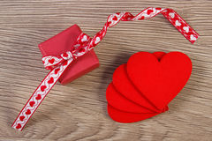 Wrapped gift with ribbon and heart for Valentines Day Royalty Free Stock Image