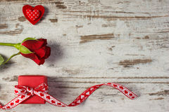 Wrapped gift with ribbon, red heart and rose for Valentines Day, copy space for text Royalty Free Stock Photos