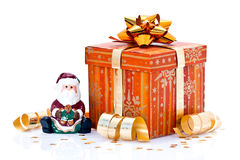 Wrapped gift and Santa figure Stock Photo