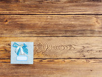 Wrapped Gift on Wooden Background Stock Photos