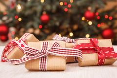 Free Wrapped Gifts And Christmas Tree With Lights In Background Royalty Free Stock Images - 82859599
