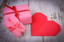 Wrapped gifts for birthday, valentine or other celebration and red heart Royalty Free Stock Photography
