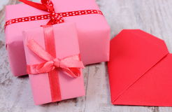 Wrapped gifts for birthday, valentine or other celebration and red heart Stock Photography
