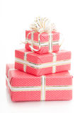 Wrapped gifts with a bow on a white background Stock Photo